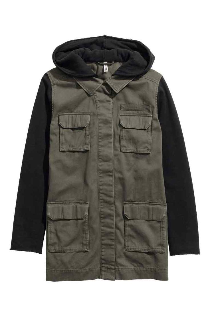 Hooded cargo jacket: Cargo jacket in washed cotton twill with a hood and sleeves in sweatshirt fabric, concealed fasteners at the front and flap chest and front pockets with fasteners. Raw edges around the hood and cuffs. Unlined.
