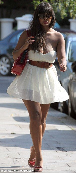 Jameela Jamil nearly has a wardrobe malfunction as her summer dress struggles to contain her ...
