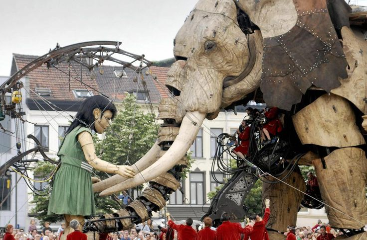 The Sultan's Elephant, an 11 meter-high mechanical elephant, and a giant marionette of a little girl, part of an outdoor theatre production by Royal de Luxe in Antwerp, on July 7, 2006.