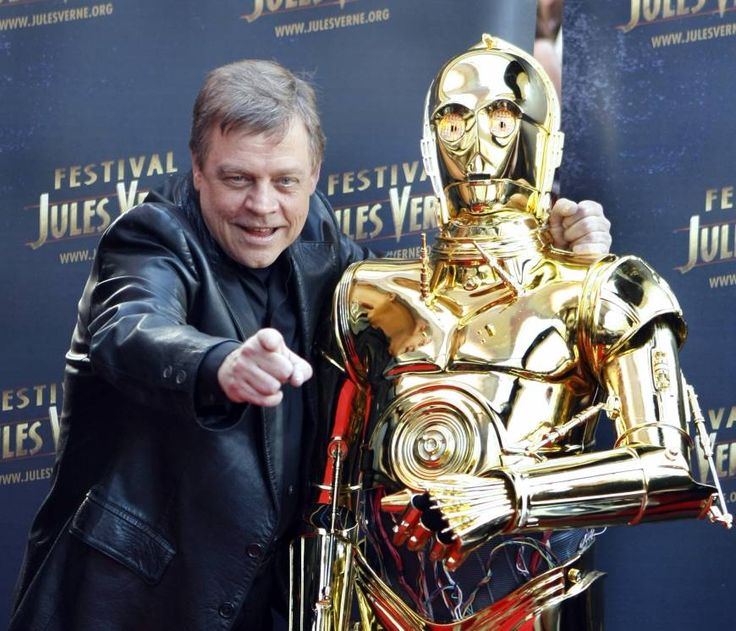 U.S. actor Mark Hamill, who played Luke Skywalker in the George Lucas Star Wars saga, poses with a figure of the character C3PO.