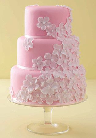 "'White on Pink' wedding cake    : Madagascar vanilla bean cake, vanilla bean,  buttercream raspberry preserve, Satab ribbon, handmade  sugar blossoms.    (for alternatives please see 'Fillings & flavours')    Price as shown:  3 tiers (6"", 8"" & 10"")  £765 (stand not included)"