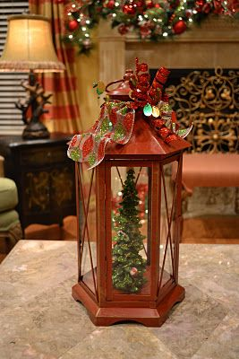 Christmas Tree Lanterns...I would out an LED light in top inside of lantern using two sided tape to shine down and illuminate the tree...would be awesome...LOVE IT!!!!