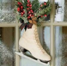 Creative Reuse: Ice Skate Holiday Decoration Plow & Hearth your old ice skates — here's a fun and cute reuse.    Stuff the skate with your favorite holiday brush — anything from tree branches to cranberries, hang it from your door and you're all set. If you want it extra wintery, you can easily spray it with some of that faux snow spray.