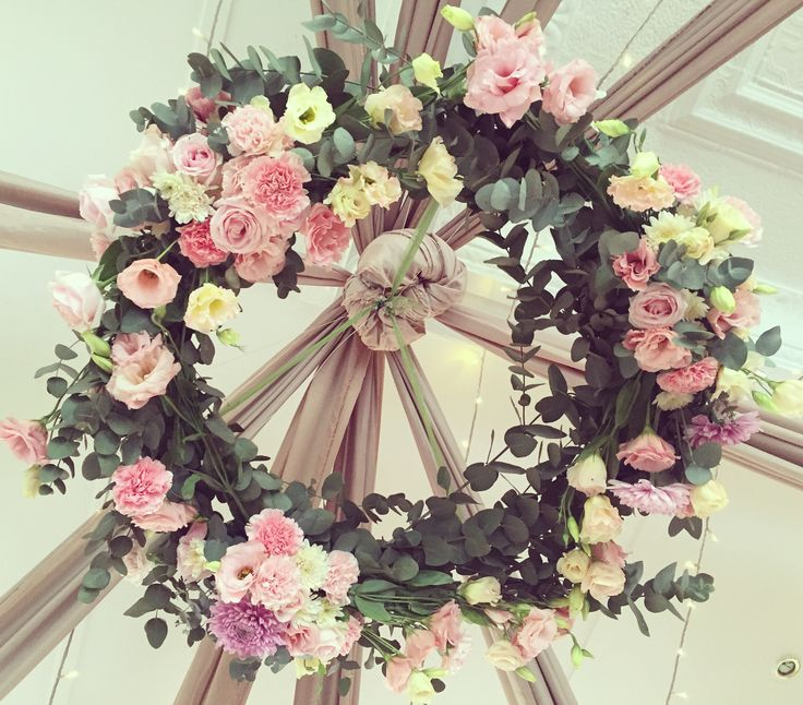 A beautiful wreath hung above your dance floor adds such a statement to your wedding. Designed by Bliss Floral Creations
