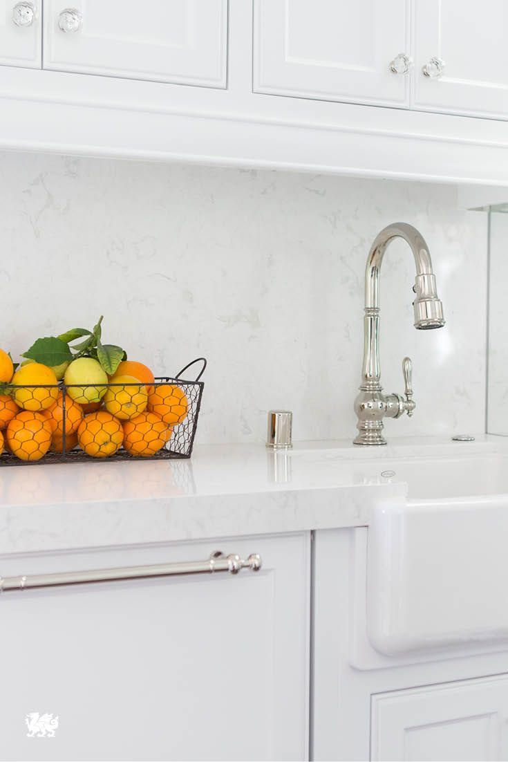 Modern kitchen with snow white quartz counter long peninsula and white - Maria Menounos Knows How To Create A Flawless Transition From Her White Countertops To Her Backsplash