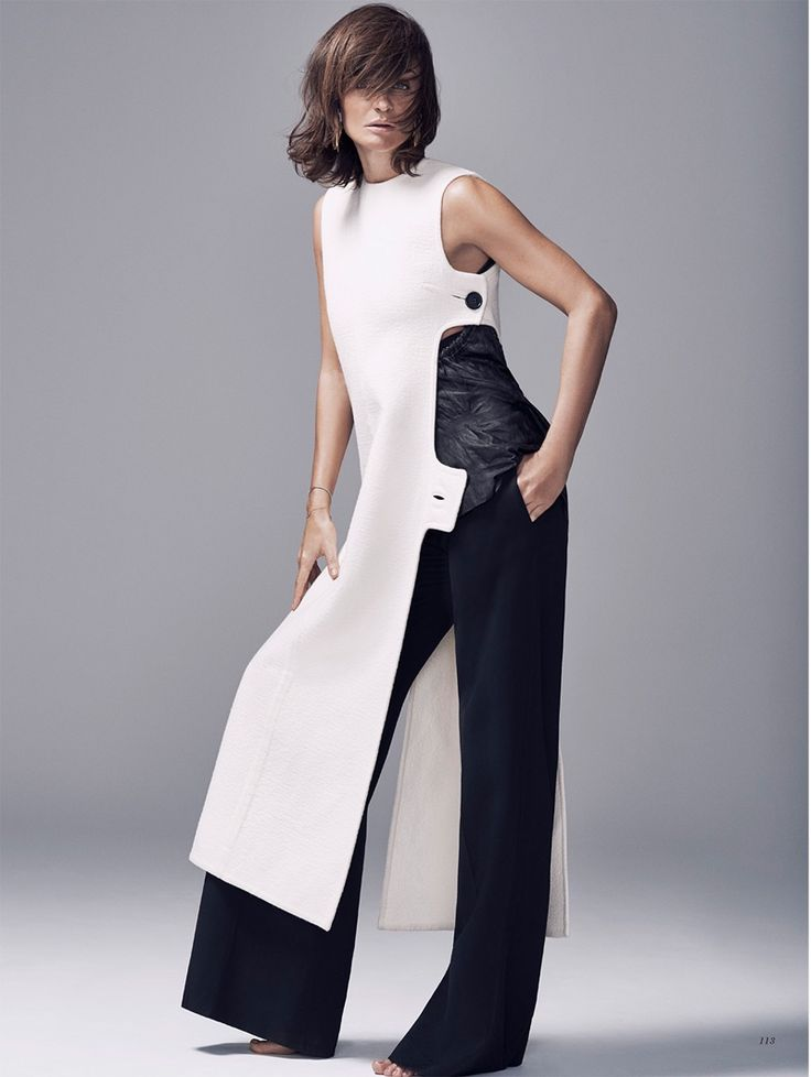 Hitting the studio, Helena Christensen wears a white tunic and black trousers from Celine