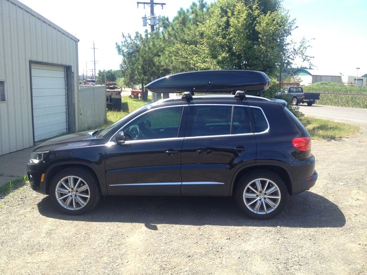 Black Packasport 71ss Roof Top Carrier On A VW Tiguan.