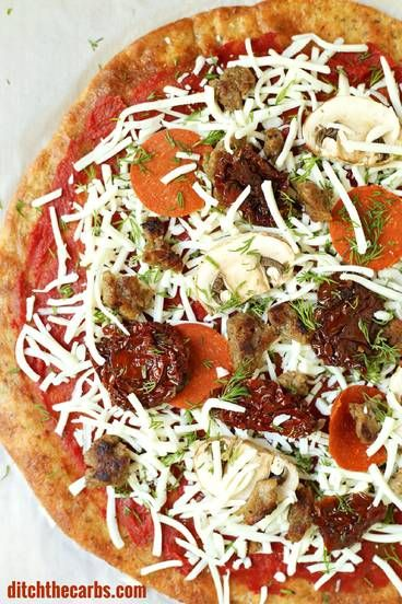 This is THE Fat Head pizza recipe, and it just got better - now with it's own quick cooking video. This is Google's number one low carb and keto pizza. Grain free, gluten free, wheat free heaven.   ditchthecarbs.com