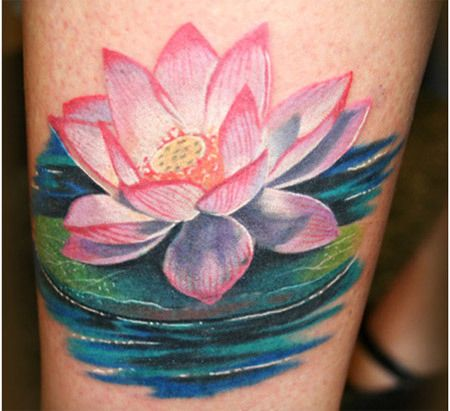 Lotus flower symbolizes realism and this tattoo shows a big lotus flower in pink ink. The pink lotus flower has red shade in the corner which is giving texture to the tattoo. The tattoo also shows blue water and green stems which makes it more realistic.