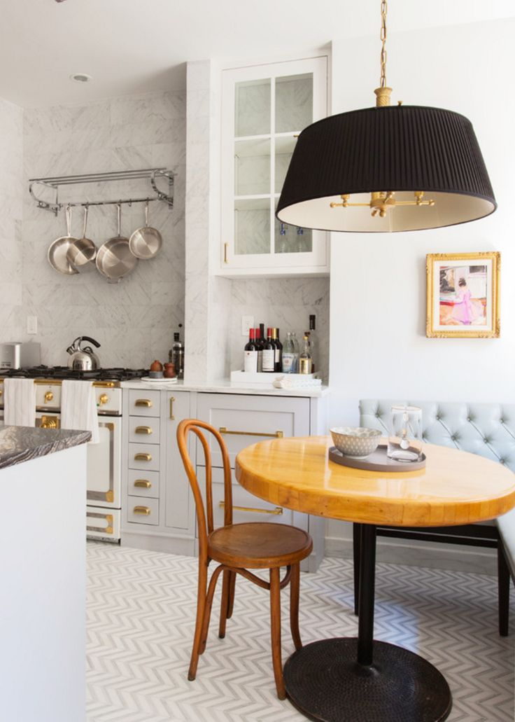 classic grey and white kitchen with brass hardware and black pendant in a gorgeous breakfast nook | via coco kelley