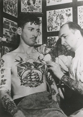 vintage military tattoos are so beautiful. and look at that placement! such a big tat for such a small chest.