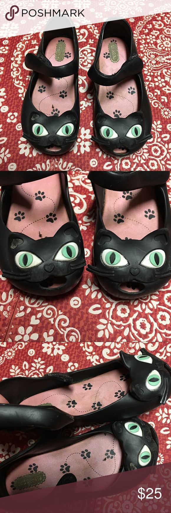 Mini Melissa black cats Authentic Mini Melissa black cats. Do show signs of wear as shown in pics including broken whiskers and dirty footbeds. Have several other pairs listed in size 9- check them out! * Sorry- the Mini Melissa shoes will not be included in the BOGO FREE sale * Mini Melissa Shoes