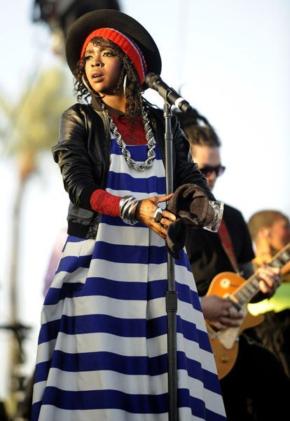 Lauryn Hill wearing jil sander..