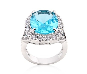 Bella Shaye Jewelry Oval Blue Topaz Ring In Rhodium With Large Cz Center Stone