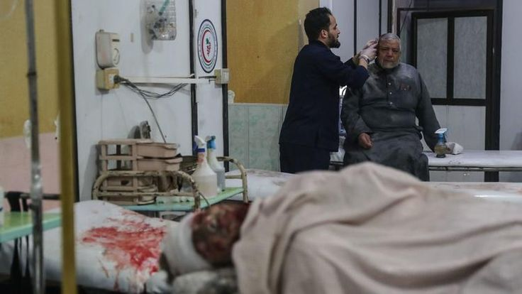 It's a new year. But the outlook on some of the world's biggest problems is as dismal as ever - January 9, 2018.    Injured people receive treatment at a hospital after airstrikes hit the city of Mesraba in Eastern Ghouta, Syria, on Jan. 3. (BADRA / EPA-EFE / REX/Shutterstock)