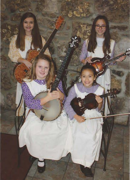 Twang is an all-girl old-time string band that grew out of the Music Roots Program in Stone County Schools to perform at regional shows and bluegrass festivals. The featured musicians, ages 9-12, include Anna Caldwell on mandolin and fiddle, Lillyanne McCool on banjo and bass, Mary Parker on fiddle and Gabi Pervis on guitar, accompanied by their adult chaperone and bassist Crystal McCool.