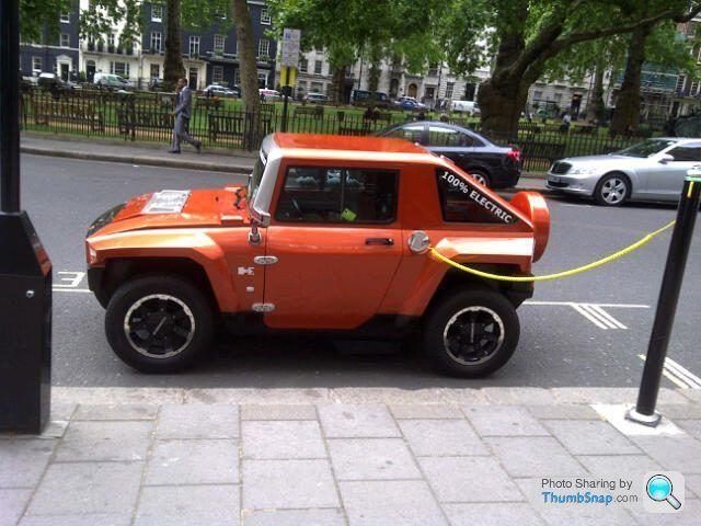 MEV HUMMER HX metallic orange being charged in London