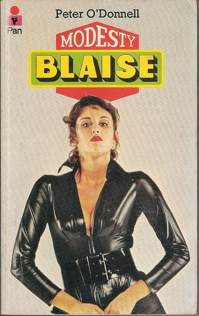 Sexy latex catsuit. Modesty Blaise paperback book cover.