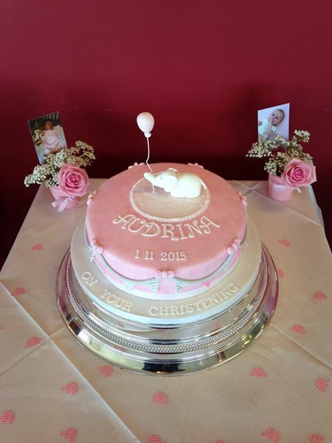 Gorgeous pink elephant christening cake with bunting