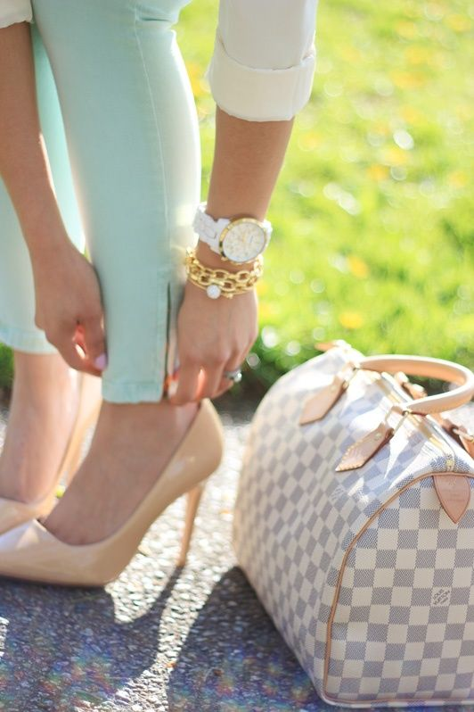 Turquoise pants, nude heels, and gold bracelets.