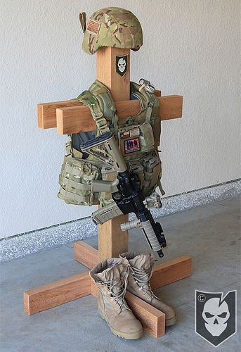 Tactical Gear Stand 04 by ITS Tactical, can easily be a DIY project. I made one for my kids hockey equipment with more options and it could be torn down and packed into his bag.