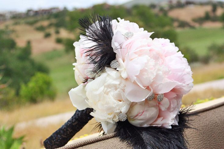 Pink peonies and black feathers