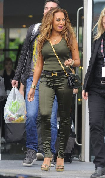 """Melanie Brown Photos Photos - """"X Factor"""" guest judge and former Spice Girl Mel B (Scary Spice) leaves the Lowry Hotel in Manchester, England in a skin tight green outfit on June 6, 2012. - Mel B Has Gone Green In Manchester"""