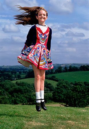 Girl in traditional dress Irish dancing outdoors in Ireland (© scenicireland.com/Christopher Hill Photographic/Alamy)