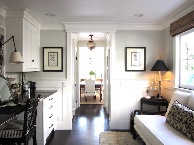 grey walls. simple white cabs. dark counter tops. dark pulls and knobs and accessories.