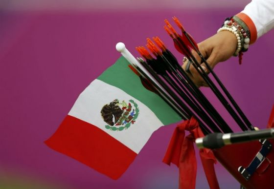 Mexico's Aida Roman takes an arrow from her quiver at the 2012 Olympic Games. Photo: Reuters