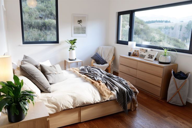 Climate House, master bedroom, ikea, throws, wooden floor