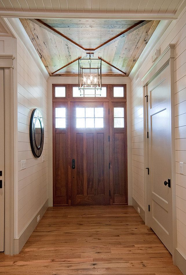 Foyer. Foyer with custom door, wood ceiling and tongue and groove walls.