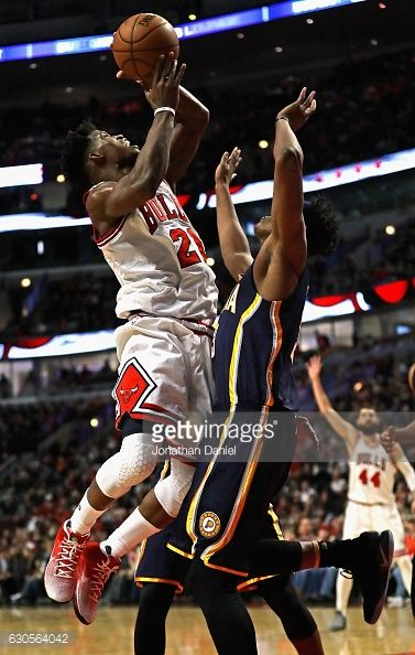 News Photo : Jimmy Butler of the Chicago Bulls is fouled by...