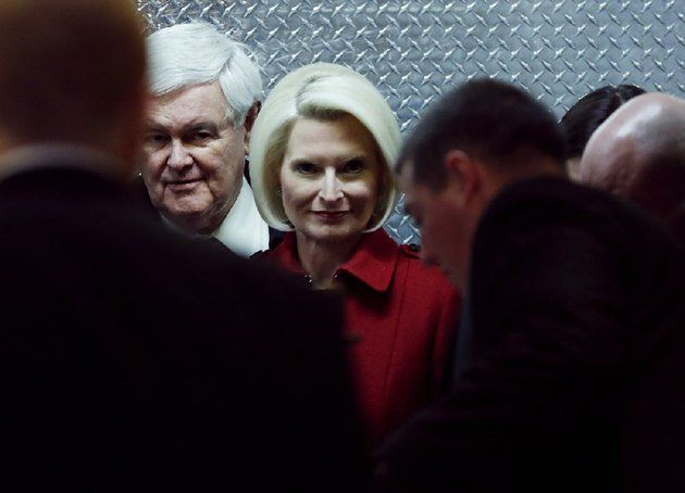 former-house-speaker-newt-gingrich-and-his-wife-callista-look-out-of-an-elevator-monday-after-their-arrival-at-trump-tower-in-new-york