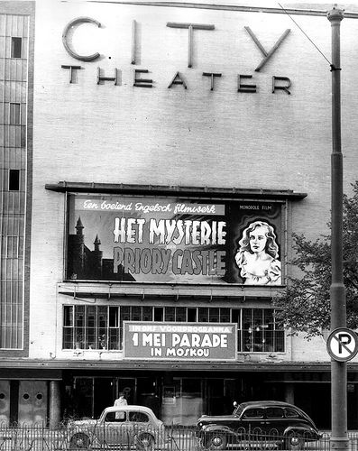 """1947. City Theater in Amsterdam Showing the movie """"The Case of the Frightenend Lady"""" by director George King"""". Photo AHF, Collectie IISG / Ben van Meerendonk. #amsterdam #1947 #CityTheater"""