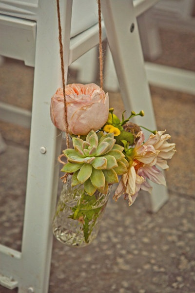 Mixing classic #flowers with other plants like succulents is a trend we totally love for #wedding decor.: Marine, Hanging Flowers, Capturedbyaime Com, Glasses Jars, Aisle Flowers, Hanging Mason Jars, Aisle Decor, Beaches Wedding, Boho Flowers