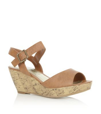 Add a little height to your everyday summer style with a pair of these low rise tan wedges.