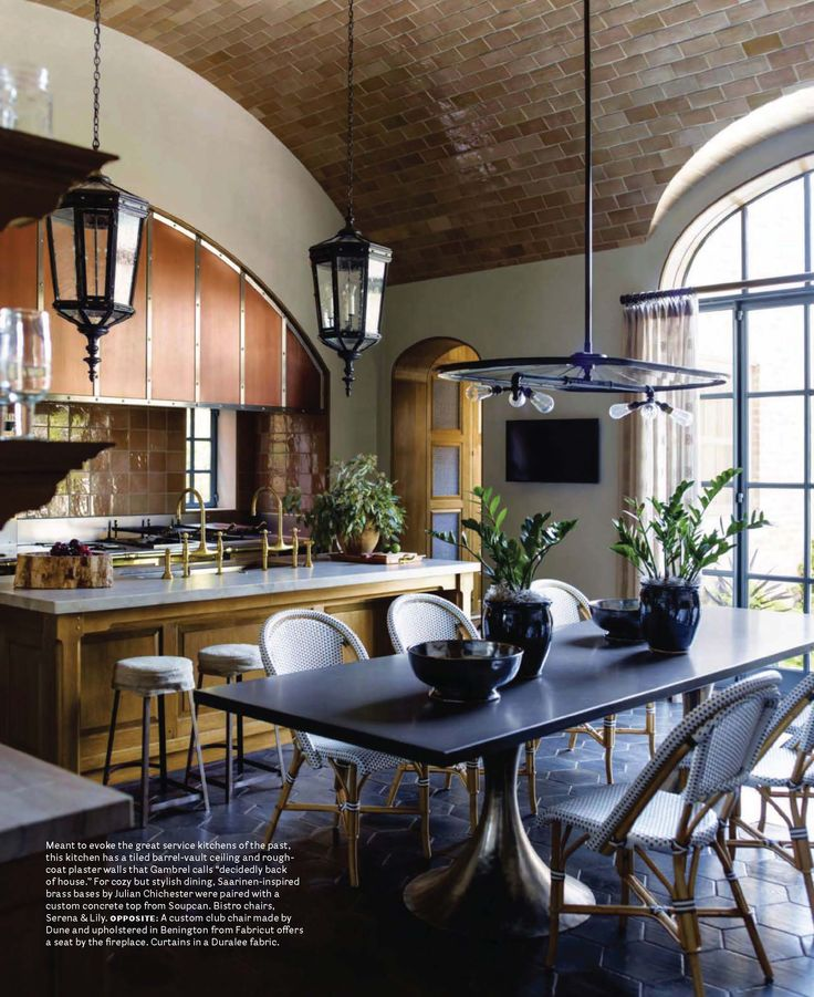 """Meant to evoke the great service kitchens of the past. This kitchen has a tiled barrel-vault ceiling and rough-coat plaster walls."" House Beautiful Magazine"
