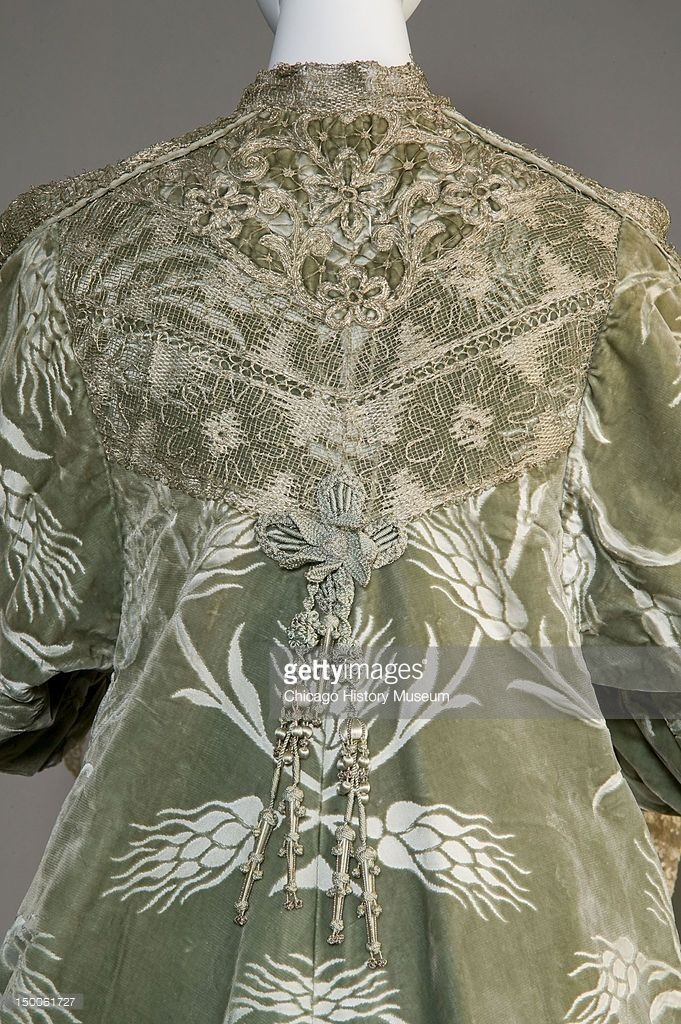 Bertha Palmer's evening coat, ca 1902 (back detail). Silk satin with cut velvet in wheat pattern, metallic thread lace, silk metallic tassels by Worth. Bertha Palmer (nee Honore, 1849 - 1918) was an American socialte and buisnesswoman and was the first wife of businessman Potter Palmer.