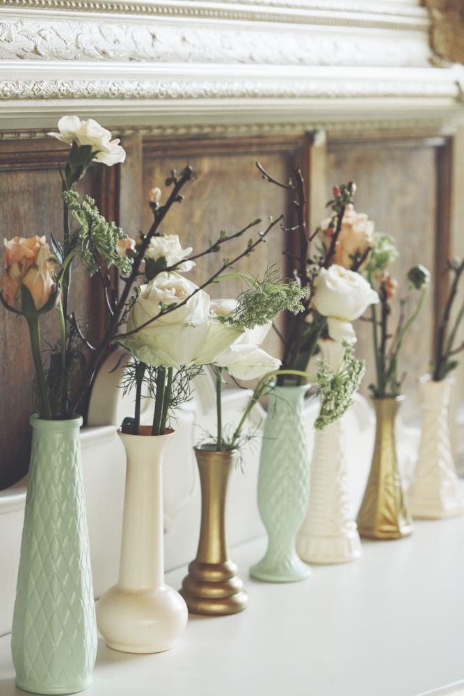 Flower Stems in Mis-Match Vases |  | Peach Wedding Inspiration From Top Essex Based Wedding Suppliers | Images by Your Wedding Story Photography | http://www.rockmywedding.co.uk/peach-wedding-inspiration/