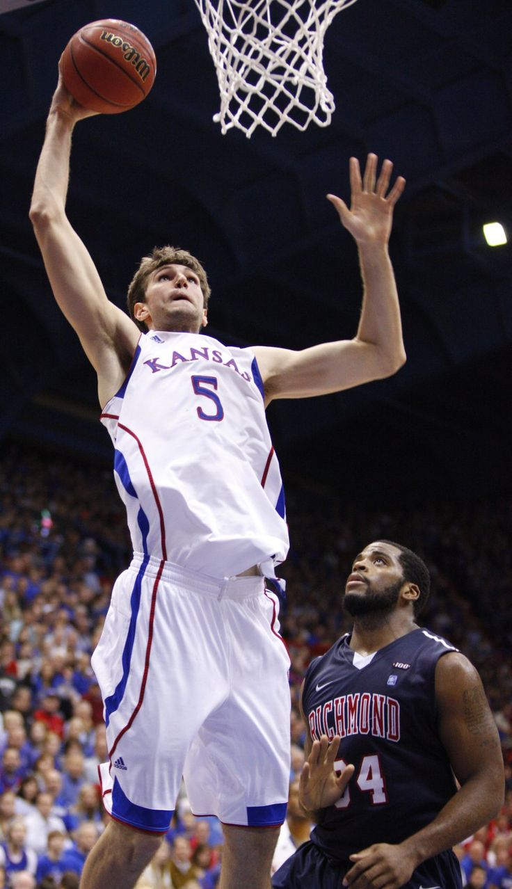 Kansas center Jeff Withey goes up for a dunk over Richmond