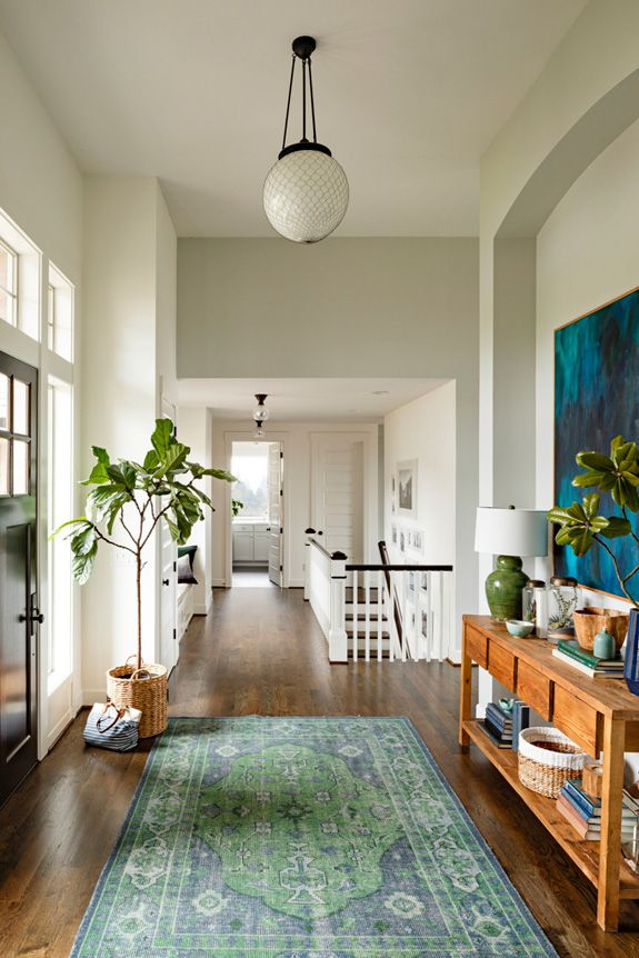 Entryway - white, hardwood floors, open, unique, charming ~ by designer Courtney Nye ~ via desire to inspire: