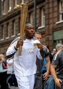 Rapper Dizzee Rascal carries Olympic Torch for London 2012