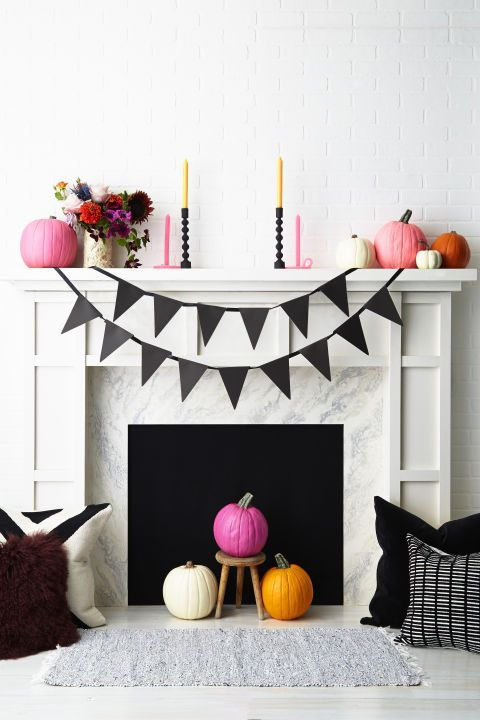 Hang A Banner Skip The Traditional Orange Decor In Lieu Of Another Hue And The Result Is Surprisingly Chic Round Out The Fireplace With A Diy Pennant