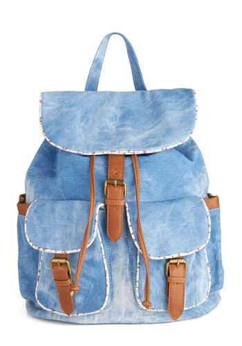Just bought this awesome little motly-denim backpack and I LOVE it. I'm evoking the 80s while finding a better way to carry gym shoes.