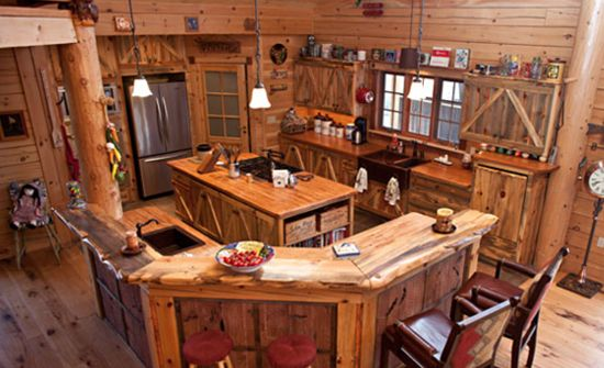Log cabin kitchen with unique cabinetry.  Has a country barn redo Feel to it
