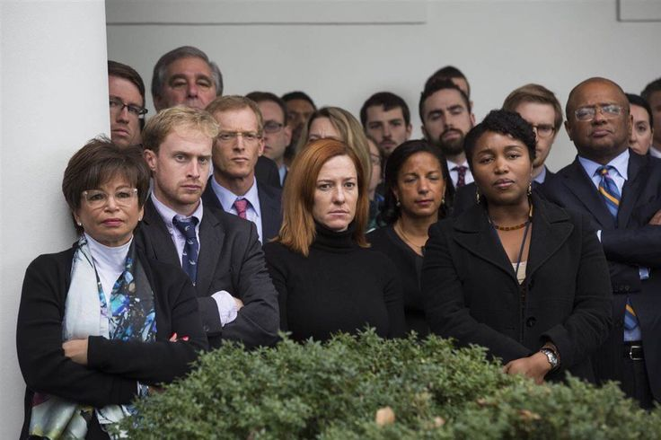 PEOPLE WAITING FOR SOMETHING TO HAPPEN - Whitehouse staff wait to greet Donald Trump for the first time.