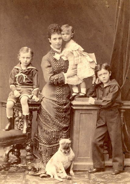 Crown princess and Grand Duchess Maria Feodorovna with children. From left to right: George, Xenia, Nicholas Romanov. 1879