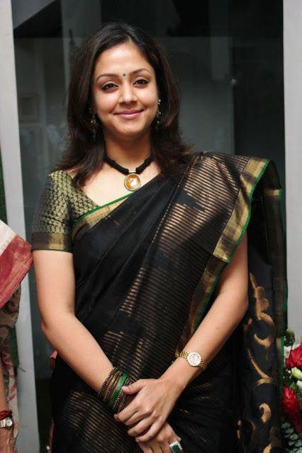Jyothik in black silk saree with gold zari border