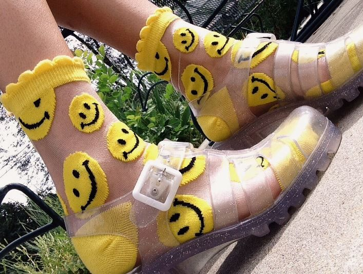 Transparent jelly sandals and semi-transparent smiley face socks.